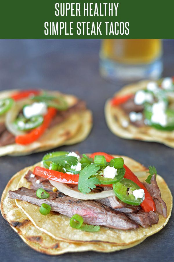 Easy Steak Taco Recipe featuring peppers, onions and goat cheese! Weight Watchers and 21 Day Fix approved! Taco Recipes the whole family will love! Check out the beer and wine pairings to make it a meal! #steakrecipes #tacorecipes #mexicanrecipes #cincodemayorecipes #weightwatchersrecipes