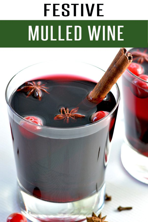 Quick and Easy Mulled Wine Recipe. This drink recipe is filled with red wine, cinnamon, honey and all your favorite winter spices. Ready in under 20 minutes! #drinkrecipes #wine #cocktailrecipes #holidayrecipes #christmasrecipes