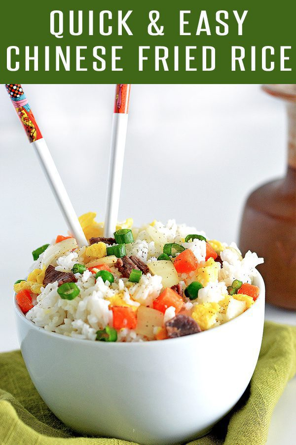 Quick Chinese Fried Rice Recipe! Easy to adapt with beef, pork, shrimp or vegetarian! Tons of veggies make up this dish. Perfect Chinese Recipe to make at home. More Asian Recipes at FoodieandWine.com #chineserecipes #ricerecipes #porkrecipes #30minutemeals #siderecipes