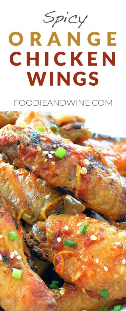 Spicy Orange Chicken Wings Recipe! Loaded with natural orange flavor and asian spices. These chicken wings can be grilled or baked! Perfect appetizer recipe for your summer barbecue. View more chicken wings recipes at FoodieandWine.com