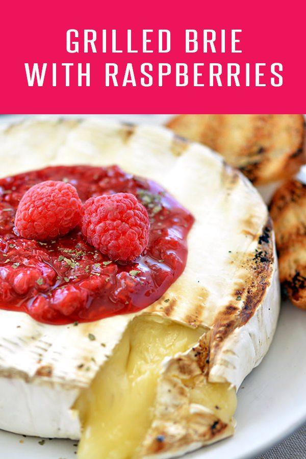 Grilled Brie Cheese With Raspberries! Brie Recipes are always a hit at parties. This brie recipe is ready in under 10 minutes! For more appetizer recipes visit FoodieandWine.com #cheeserecipes #appetizers #bbqrecipes
