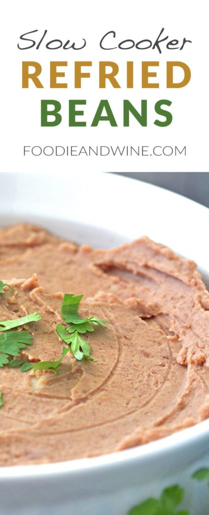 Slow Cooker Restaurant Style Refried Beans Recipe! The Mexican Food Recipe is loaded with flavor and perfect for Cinco de Mayo. Serve it next to our Carne Asada or Shrimp Cocktail Recipe. Easy to make into a Vegetarian Recipes. Click to view the recipe at FoodieandWine.com
