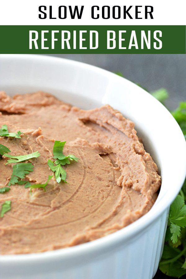Slow Cooker Restaurant Style Refried Beans Recipe! The Mexican Food Recipe is loaded with flavor and perfect for Cinco de Mayo. Serve it next to our Carne Asada or Shrimp Cocktail Recipe. Easy to make into a Vegetarian Recipes. Click to view the recipe at FoodieandWine.com #beanrecipes #slowcookerrecipes #healthyrecipes #vegetarianrecipes #healthyrecipes