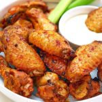 Plate of Air Fried Chicken Wings with ranch and celery stick