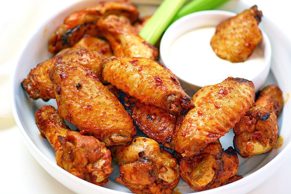 Plate of Air Fryer chicken wings with ranch and celery stick