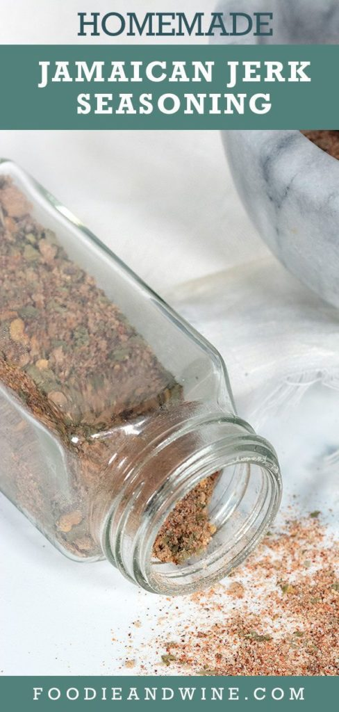 Pinterest pin showing Jerk seasoning in a clear spice jar spilled on white marble. Also shows the seasoning in a mortal and pestal.