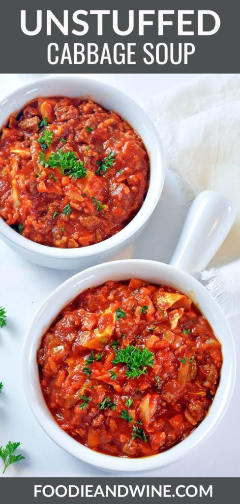 Pinterest pin showing Two white bowls full of red unstuffed cabbage soup topped with green parsley.