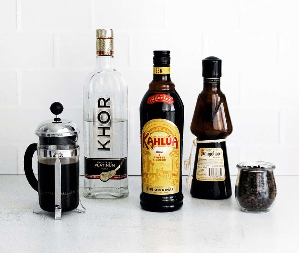 Ingredients to make an Espresso Martini: Coffee, vodka, Kahlua, Frangelico.