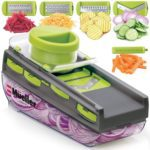Picture of a mandoline slicer with various cut vegetables.