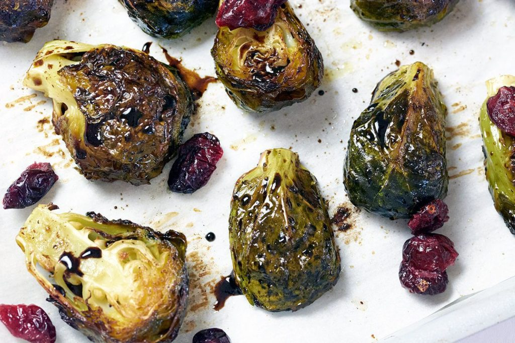 Balsamic Glazed Brussel Sprouts with dried cranberries on baking sheet.