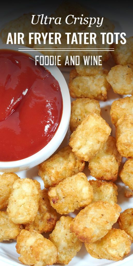 Crispy Air Fryer Tater Tots on a white plate next to a bowl of ketchup.