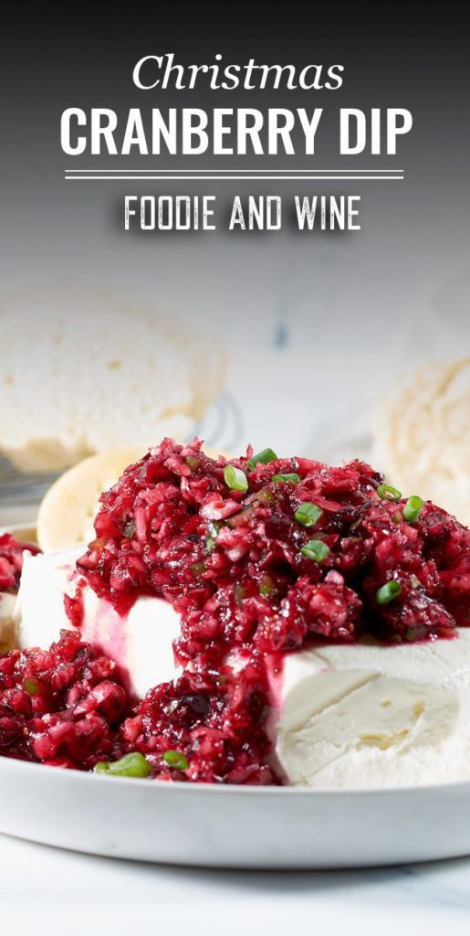 Pinterest pin showing cranberry jalapeno dip over a block of cream cheese.