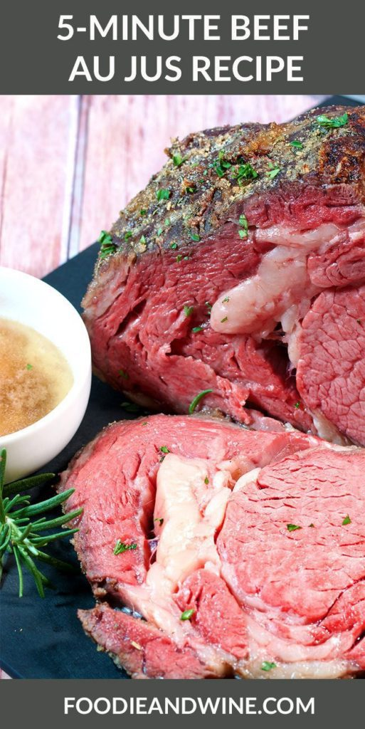 Close up picture of a rare prime rib with au jus next to it in a white bowl.
