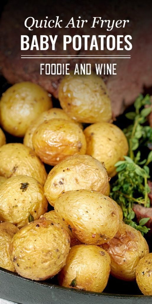"""Pinterest pin showing a close up of air fryer baby potatoes. The text """"Quick Air Fryer Baby Potatoes. Foodie and Wine"""" show up on the top of the image."""